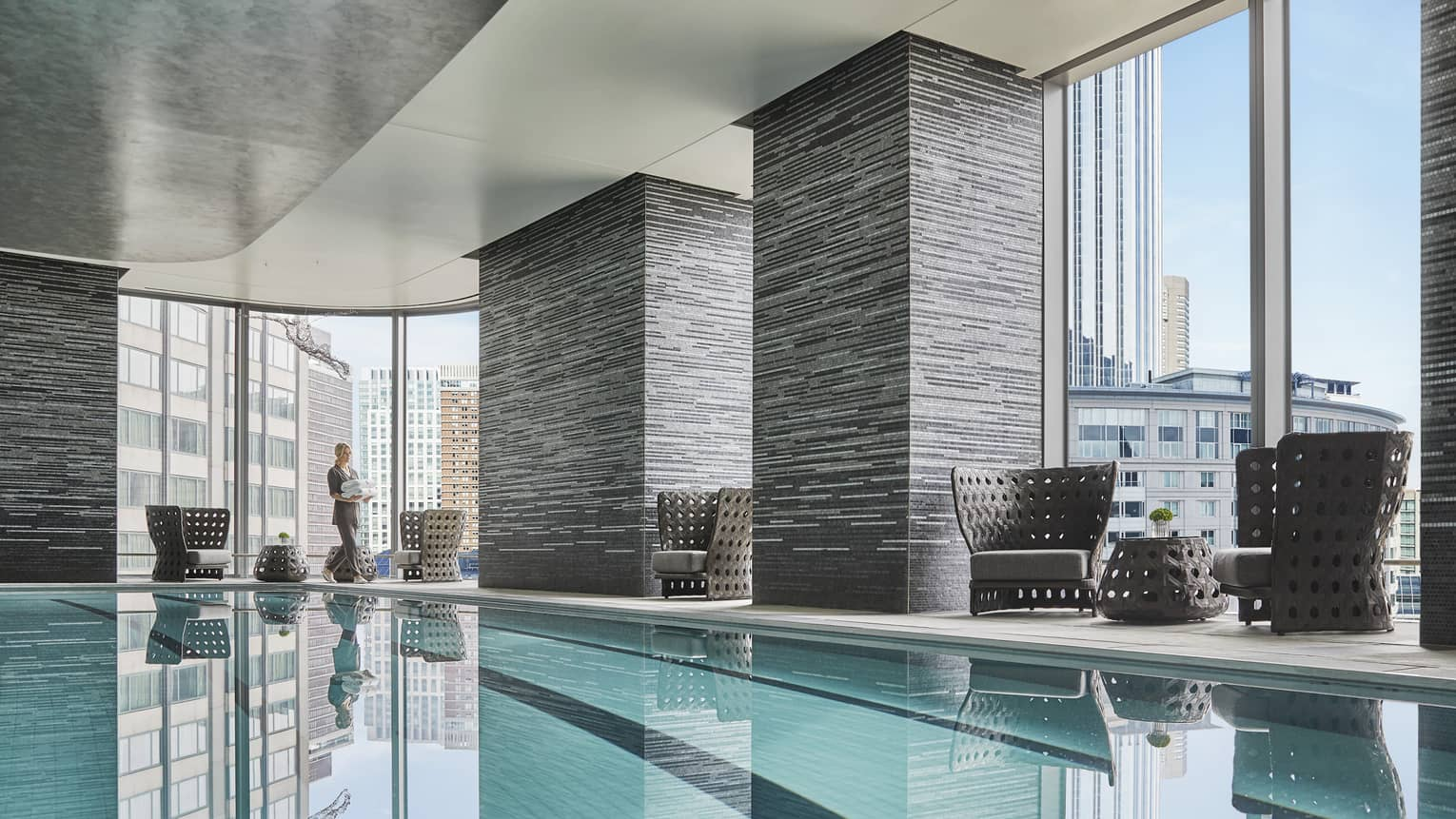 view of downtown boston skyline through the windows of the indoor pool
