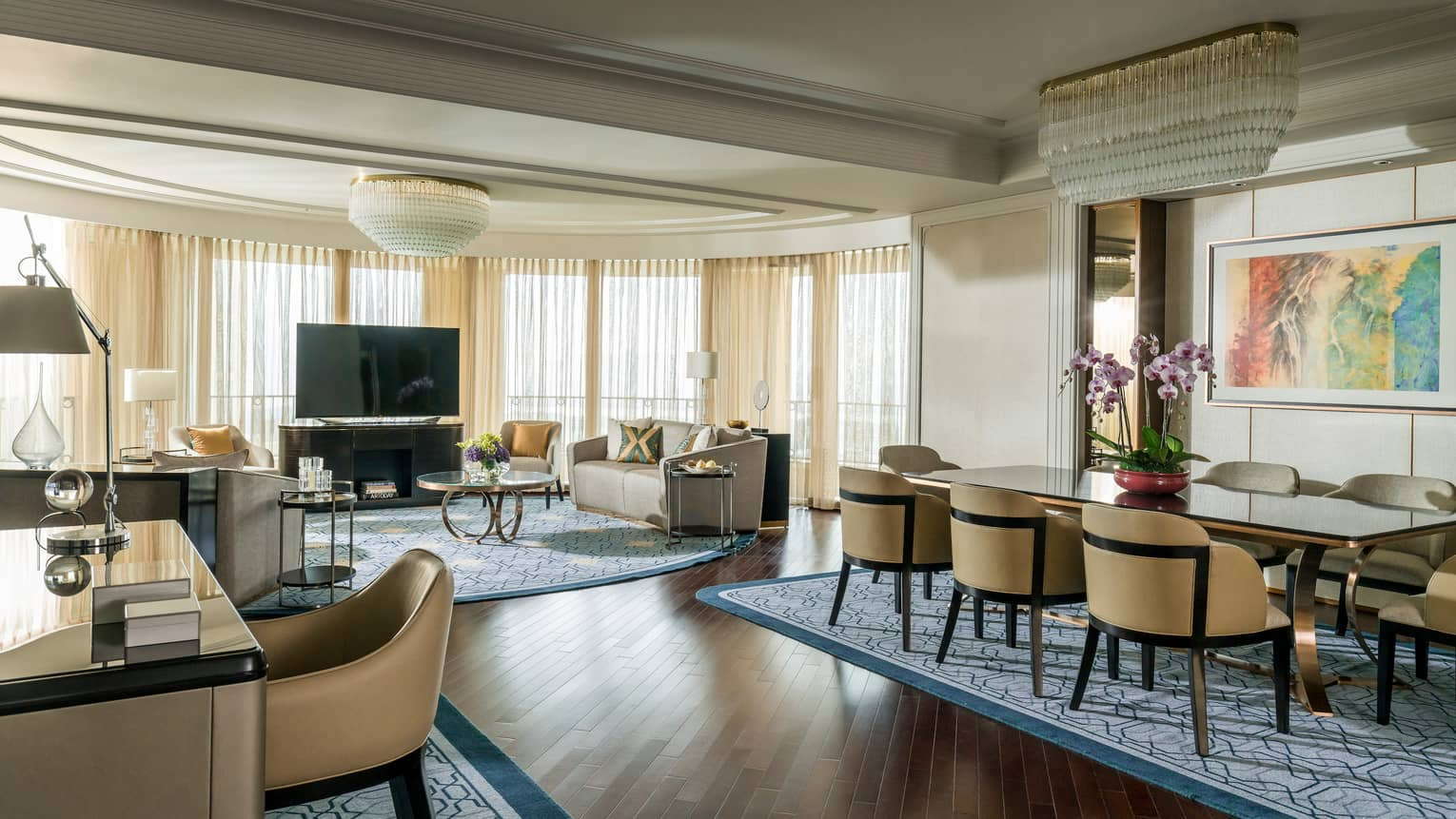 Spacious Presidential Suite desk, dining table in front of spacious living room, TV
