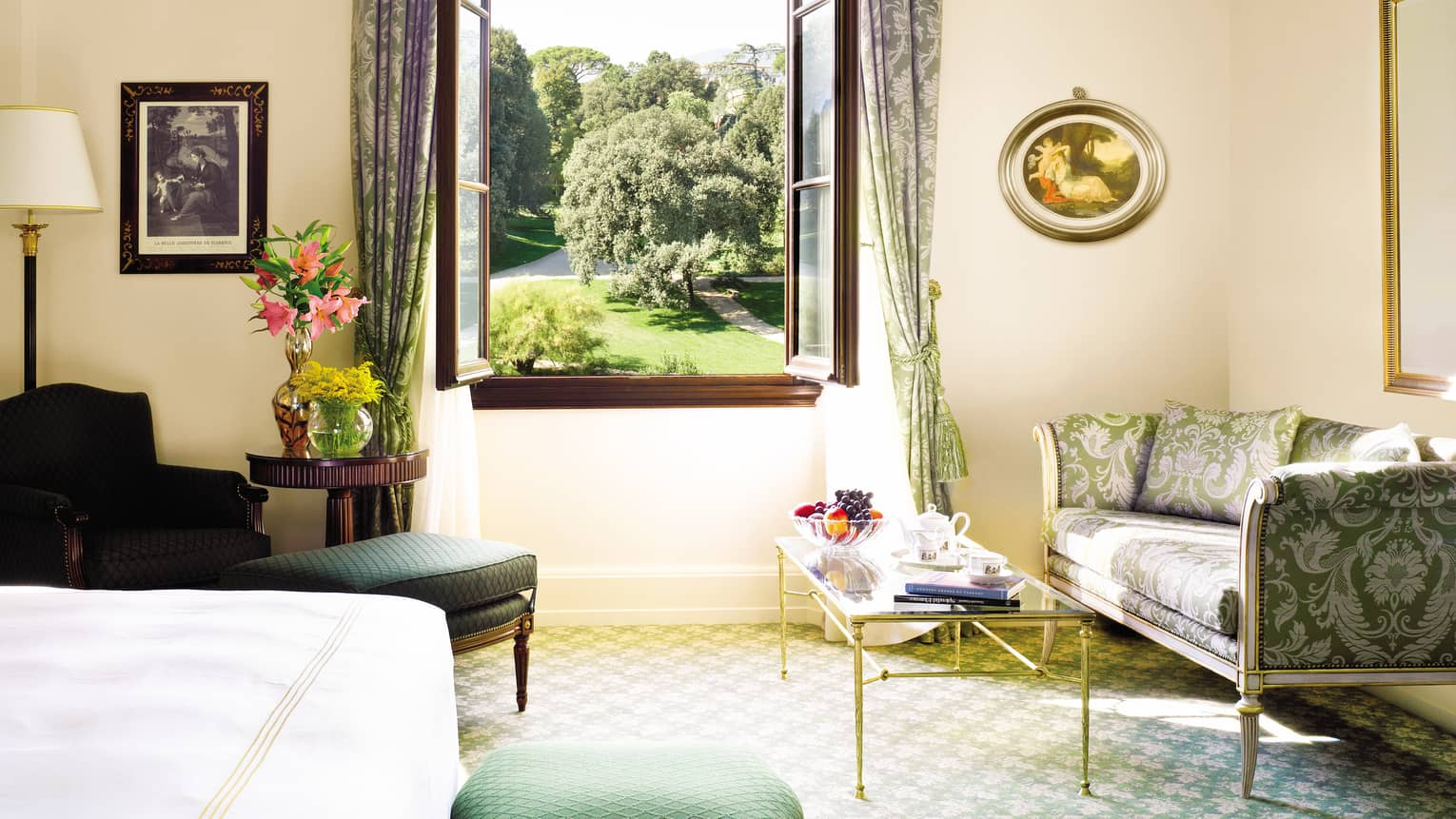 Four Seasons Room silk sofa, armchair, table under large open window overlooking gardens