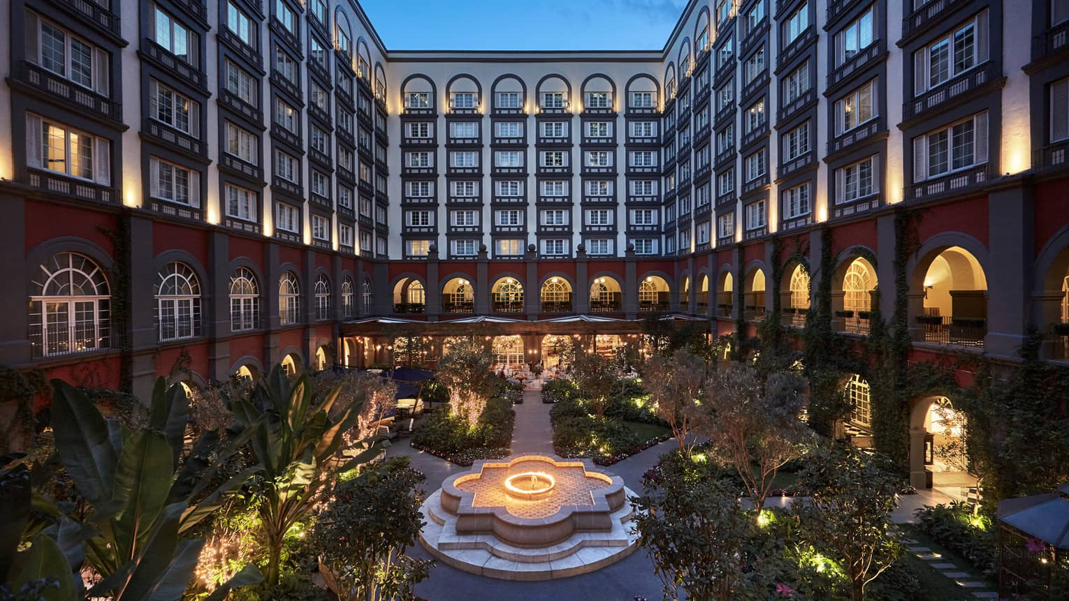 Inner courtyard garden below Four Seasons Hotel Mexico City with lights at night