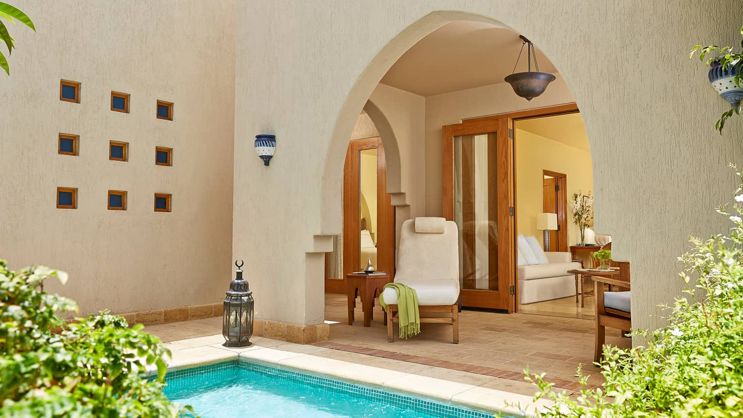 One-Bedroom Suite With Plunge Pool, plush pool chair by corner of turquoise swimming pool