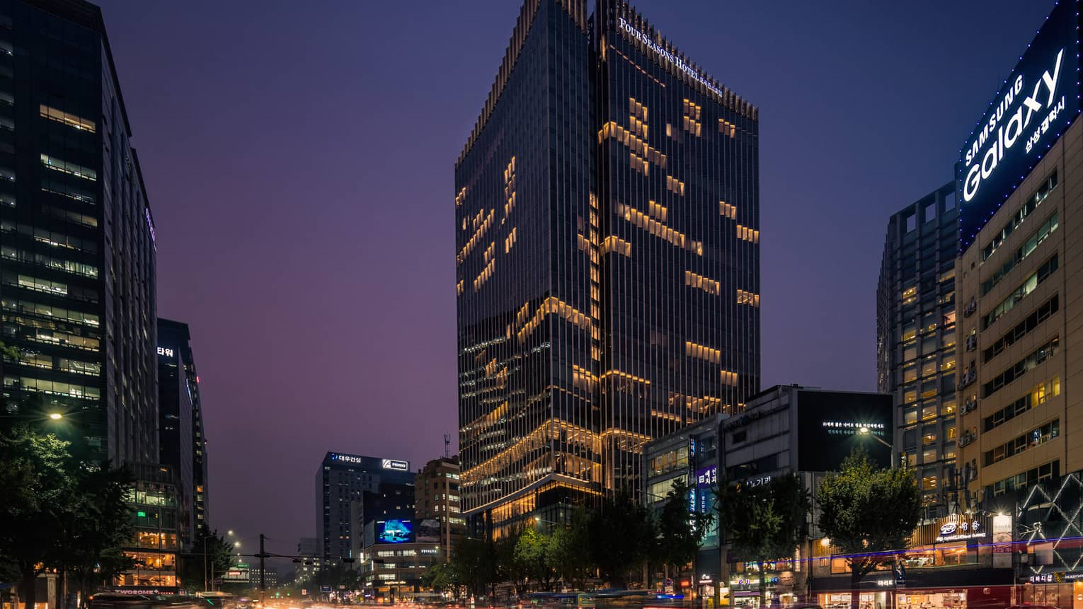 Four Seasons Hotel Seoul glass high rise building exterior with lights at night