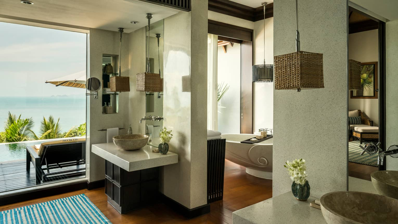 Villa bathroom with double marble sinks, freestanding tub, floor-to-ceiling window