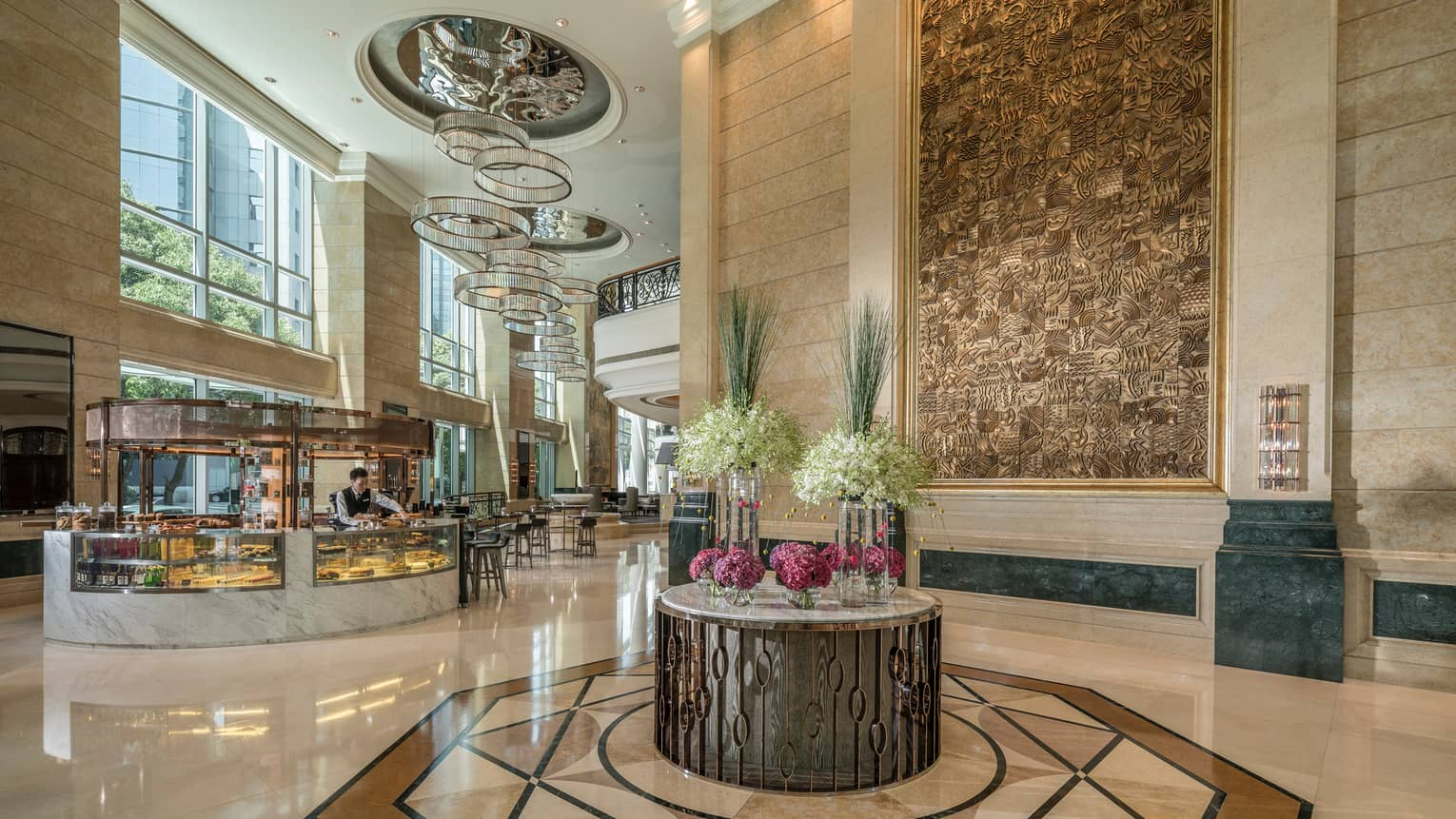 Four Seasons Hotel Shanghai lobby with high ceilings, gleaming floors, crystal chandeliers