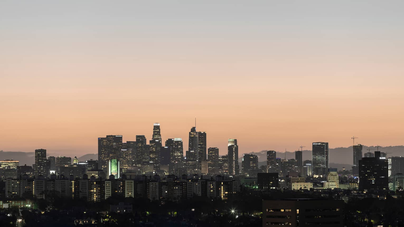 Los Angeles buildings, city skyline at sunset