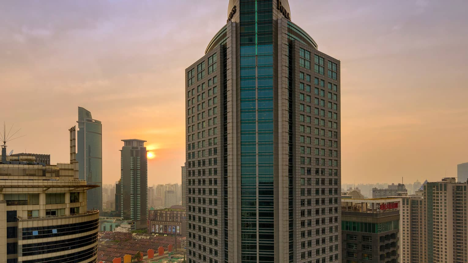 Exterior view of Four Seasons Hotel Shanghai rises 37-storey tower at sunrise