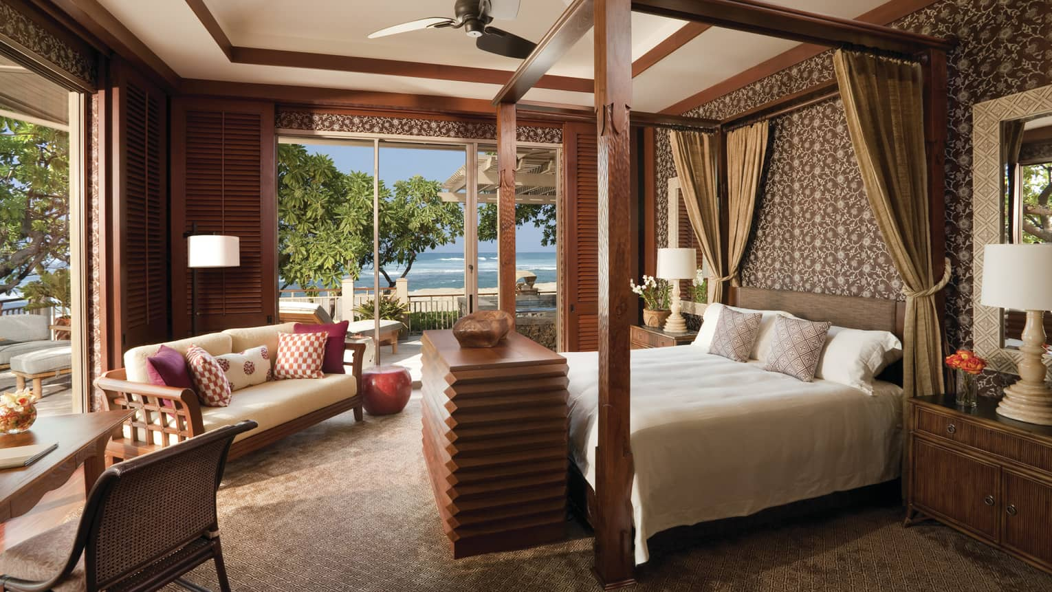 Hawaii Loa Presidential Villa sunny bedroom with wood poster bed, open walls