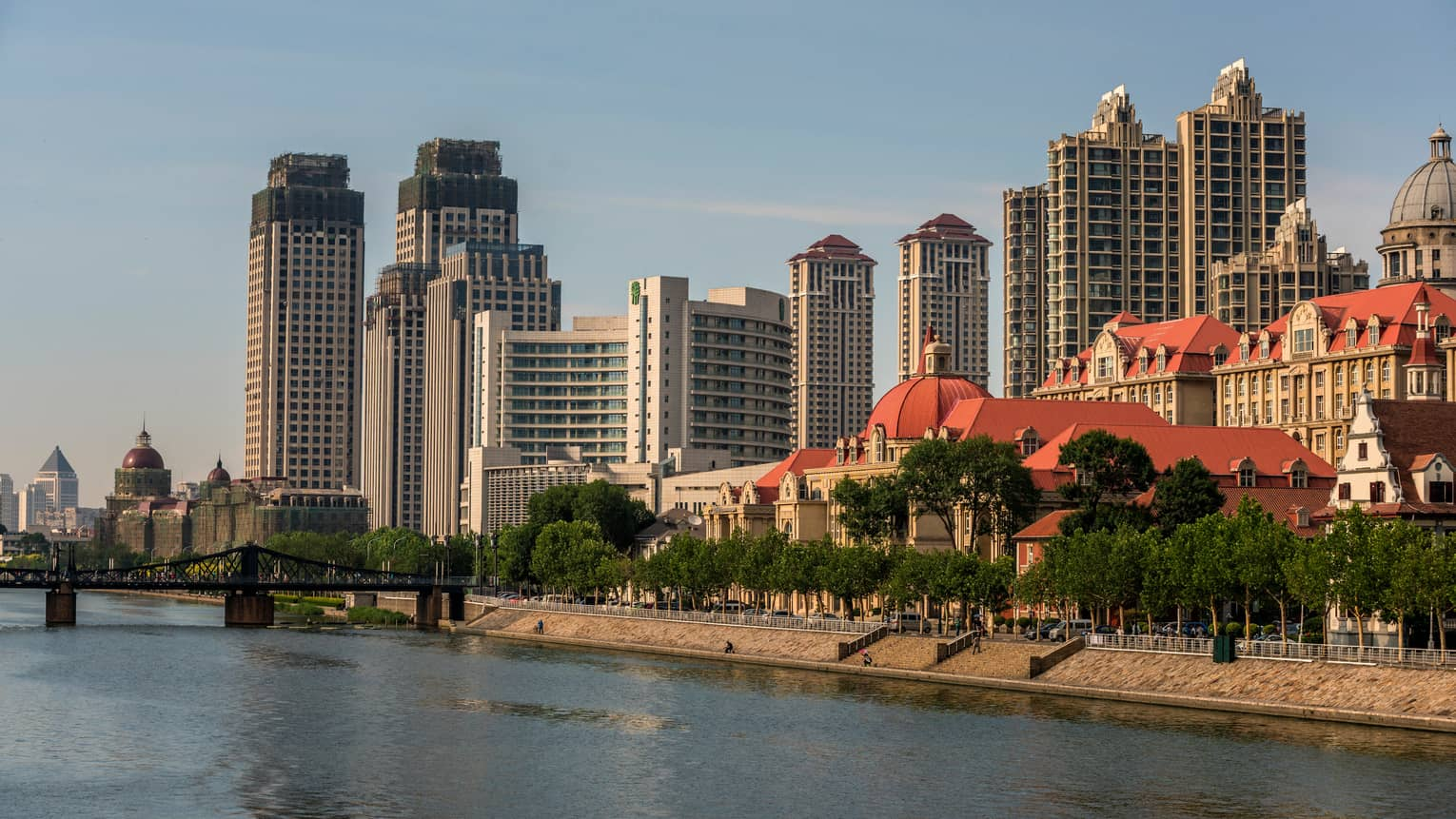 Walkway along banks of Hia River, bridge, Tianjin skyline