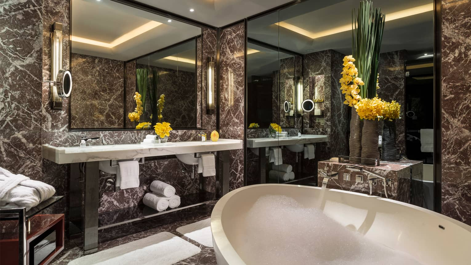 Superior Room River View bathroom full marble bathroom with white deep-soak tub, large vanity